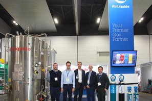 Proud Air Liquide employees in front of their NMW 2109 stand