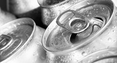 A collection of silver aluminium cans with one open
