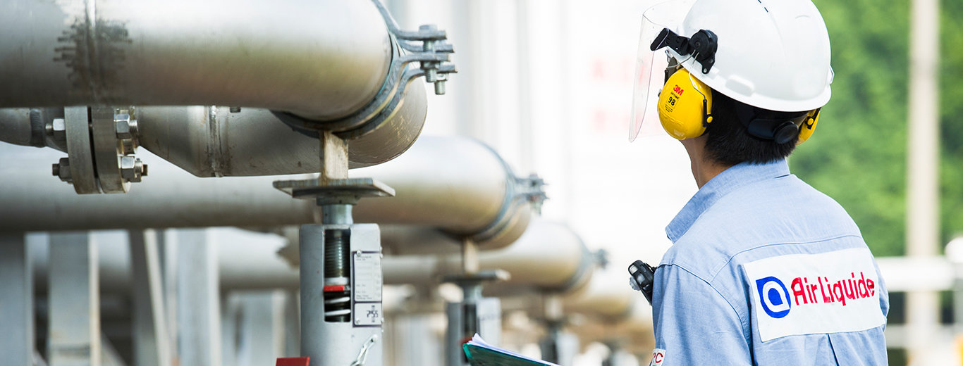 Air Liquide worker inspecting work plant